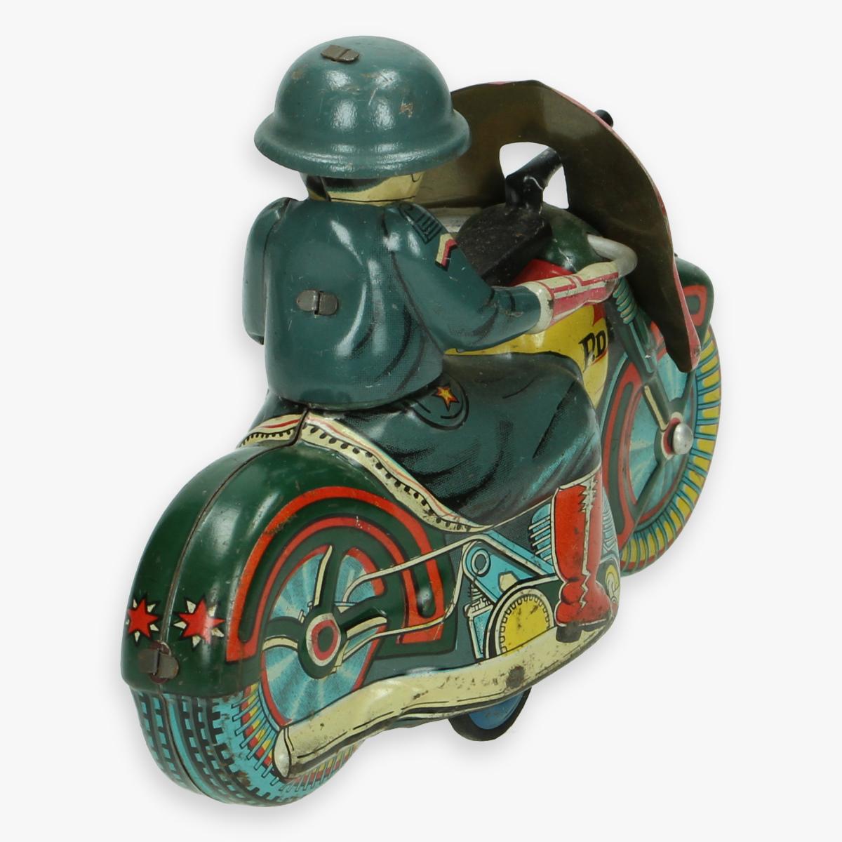 Afbeeldingen van blikken motor made in Japan army motorcycle jaren 50