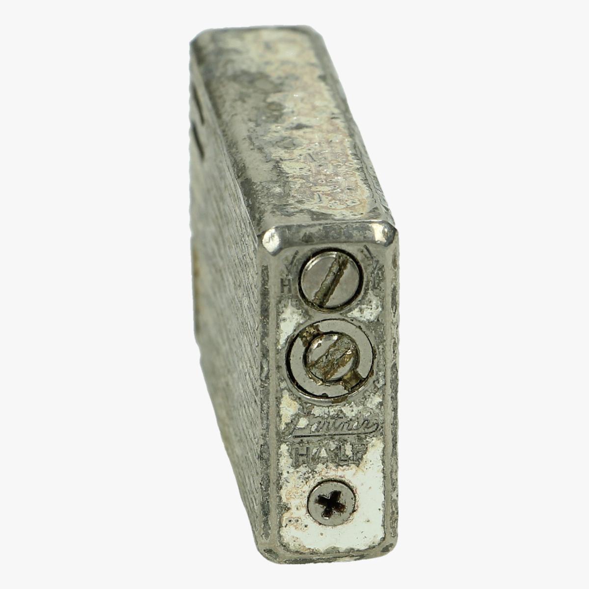 Afbeeldingen van oude aansteker patners half