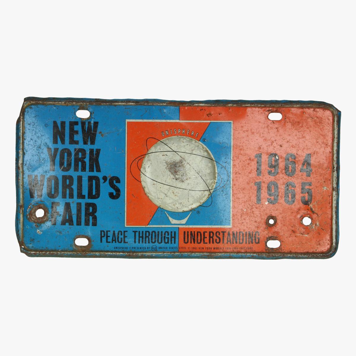Afbeeldingen van blikken bordje new york world's fair 1964/65