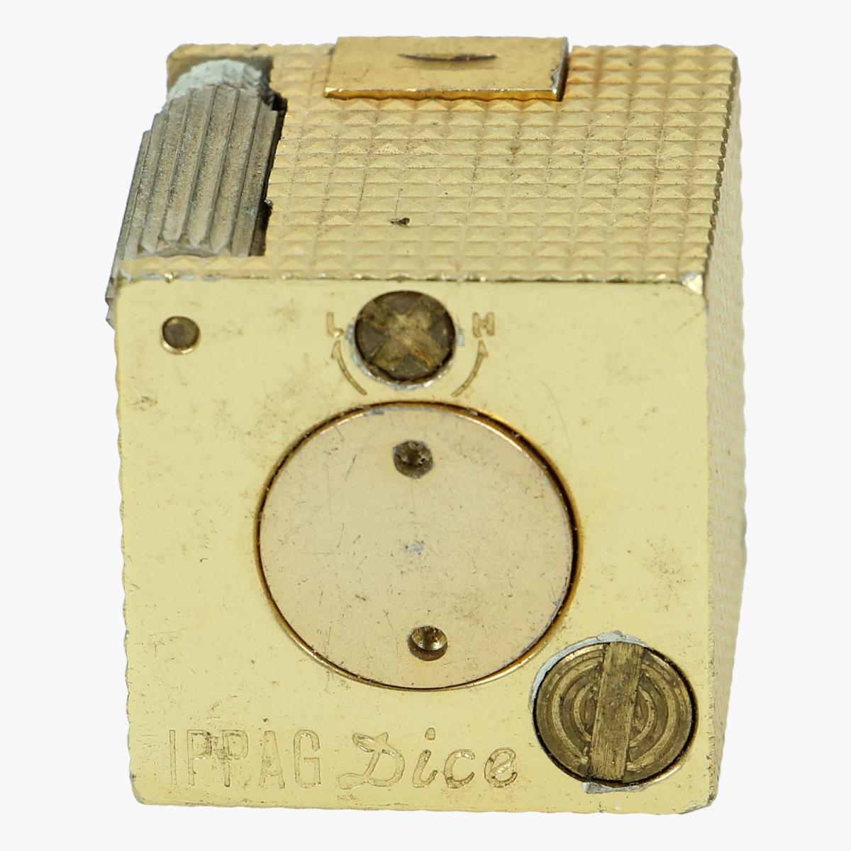 Afbeeldingen van oude aan steker D.K.E IPPAG DICE