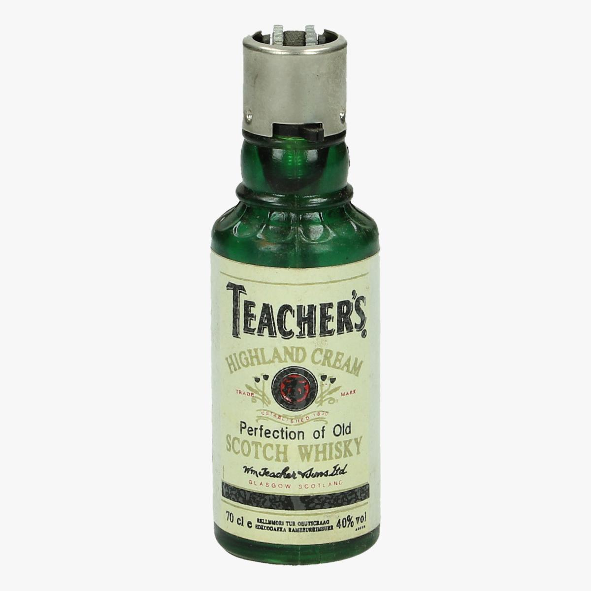 Afbeeldingen van oude aansteker flesje teacher's scotch wiskey