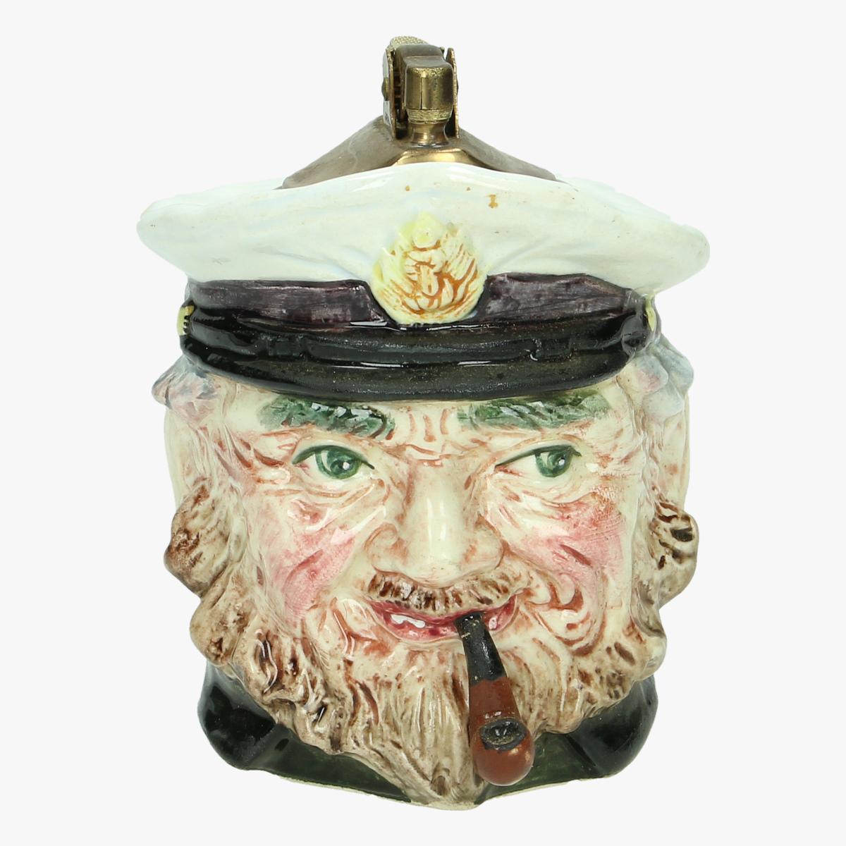 Afbeeldingen van oude aansteker porseleine zeeman