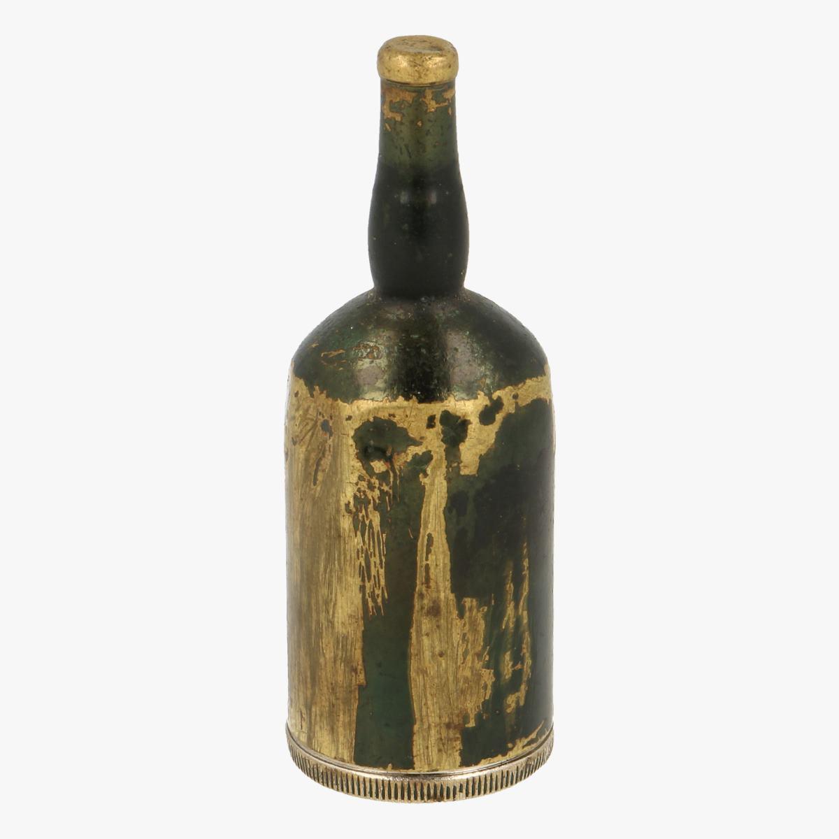 Afbeeldingen van oude aansteker flesje