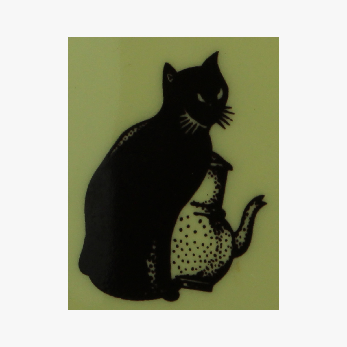 Afbeeldingen van Zwarte Kat. Koffiepot en melkpot.