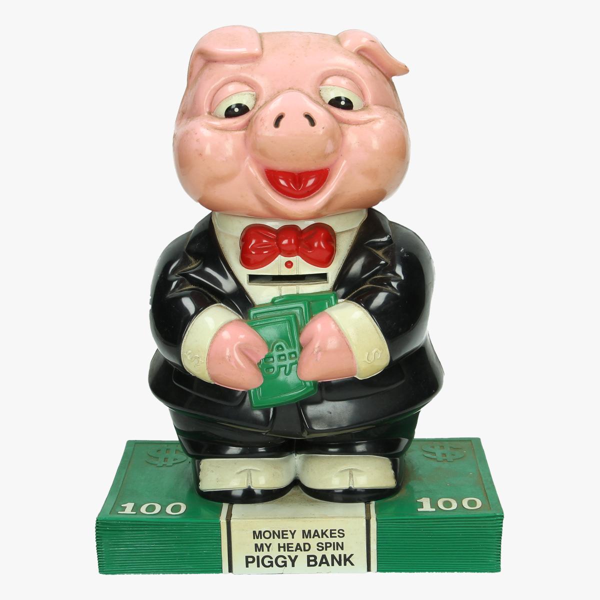 Afbeeldingen van spaarpot money makes my head spin piggy bank
