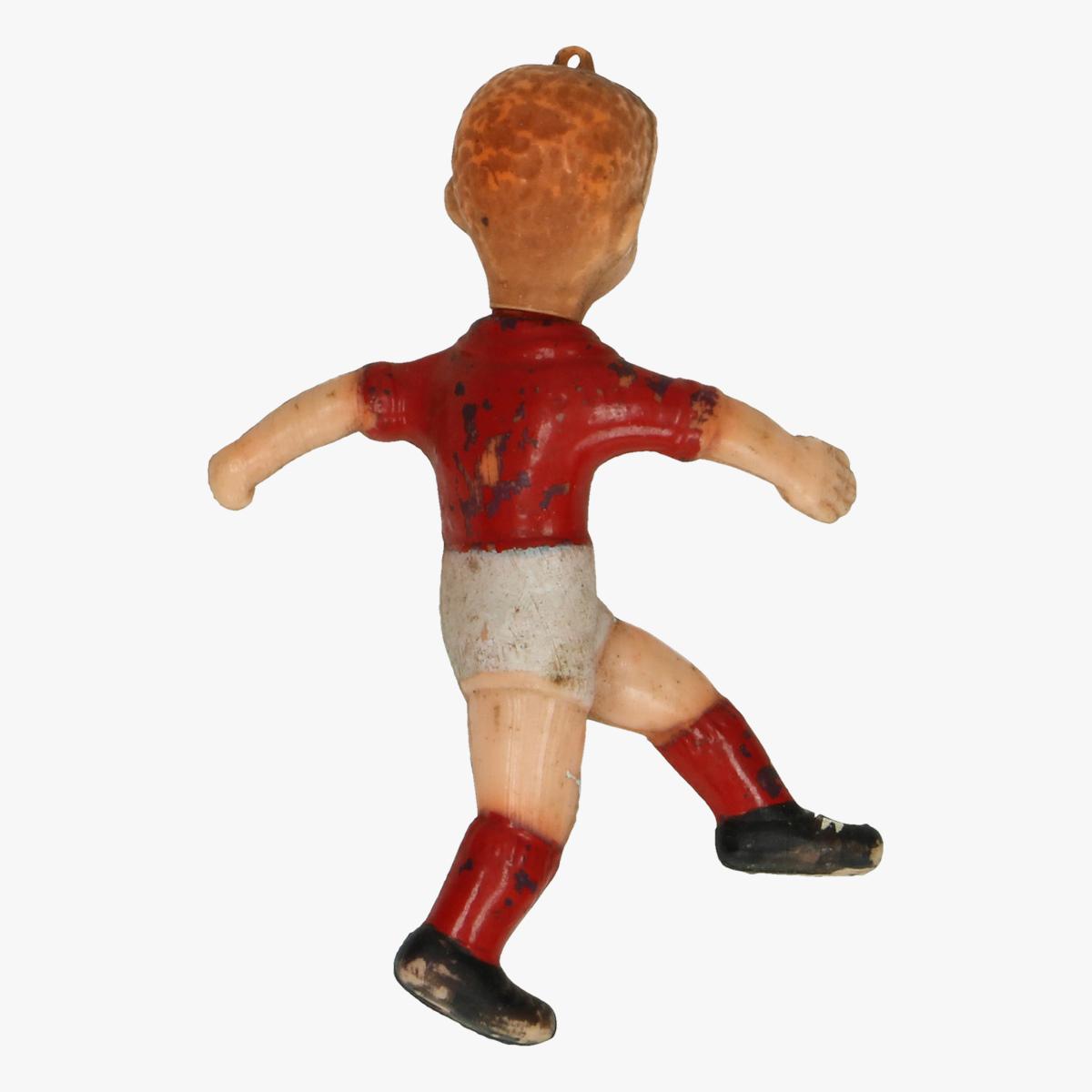 Afbeeldingen van oude plastieken voetballertje