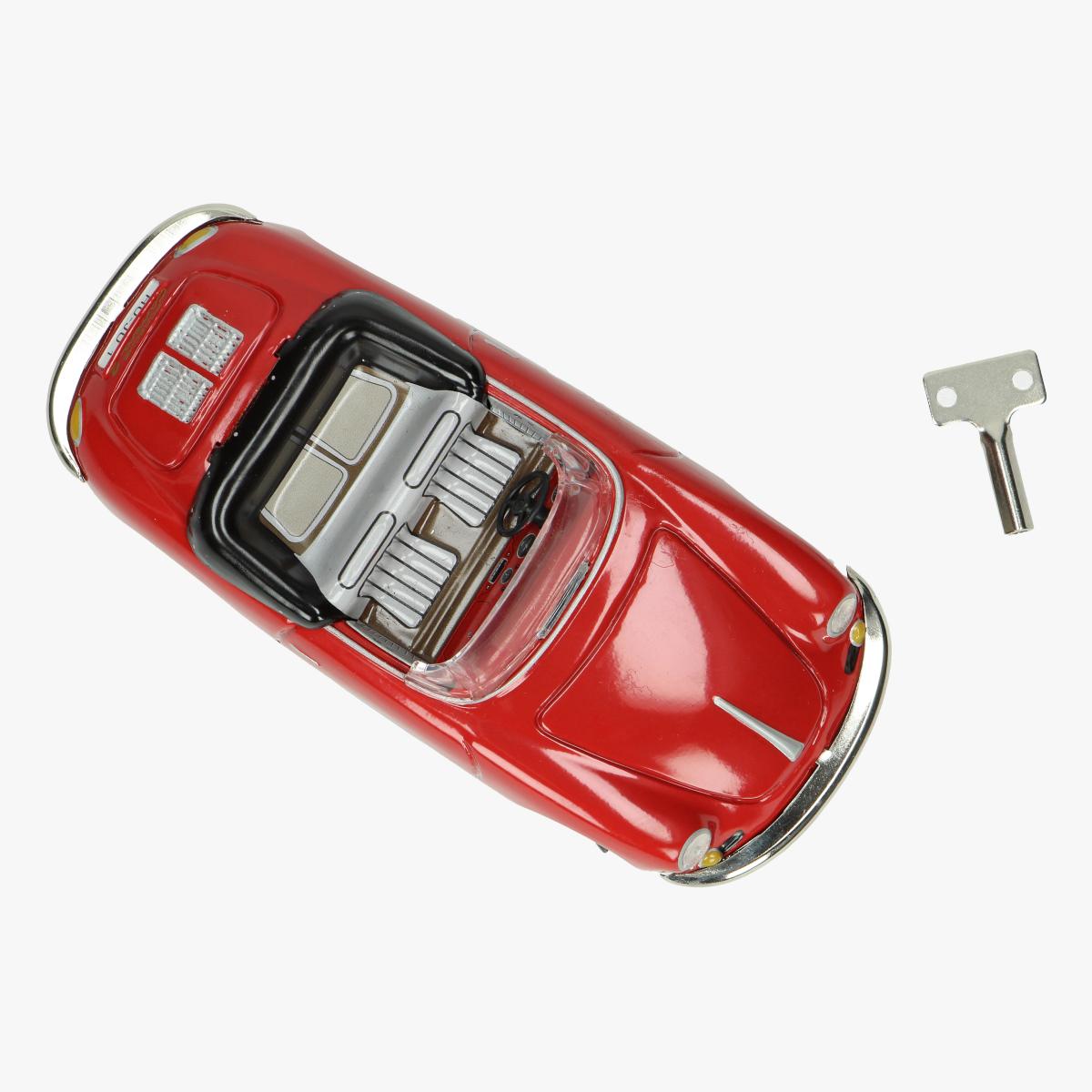 Afbeeldingen van blikken porche carrea cabriolet rood repro