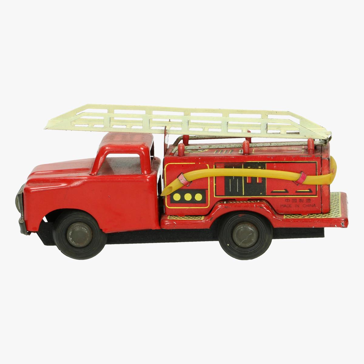 Afbeeldingen van oude blikken brandweerwagen