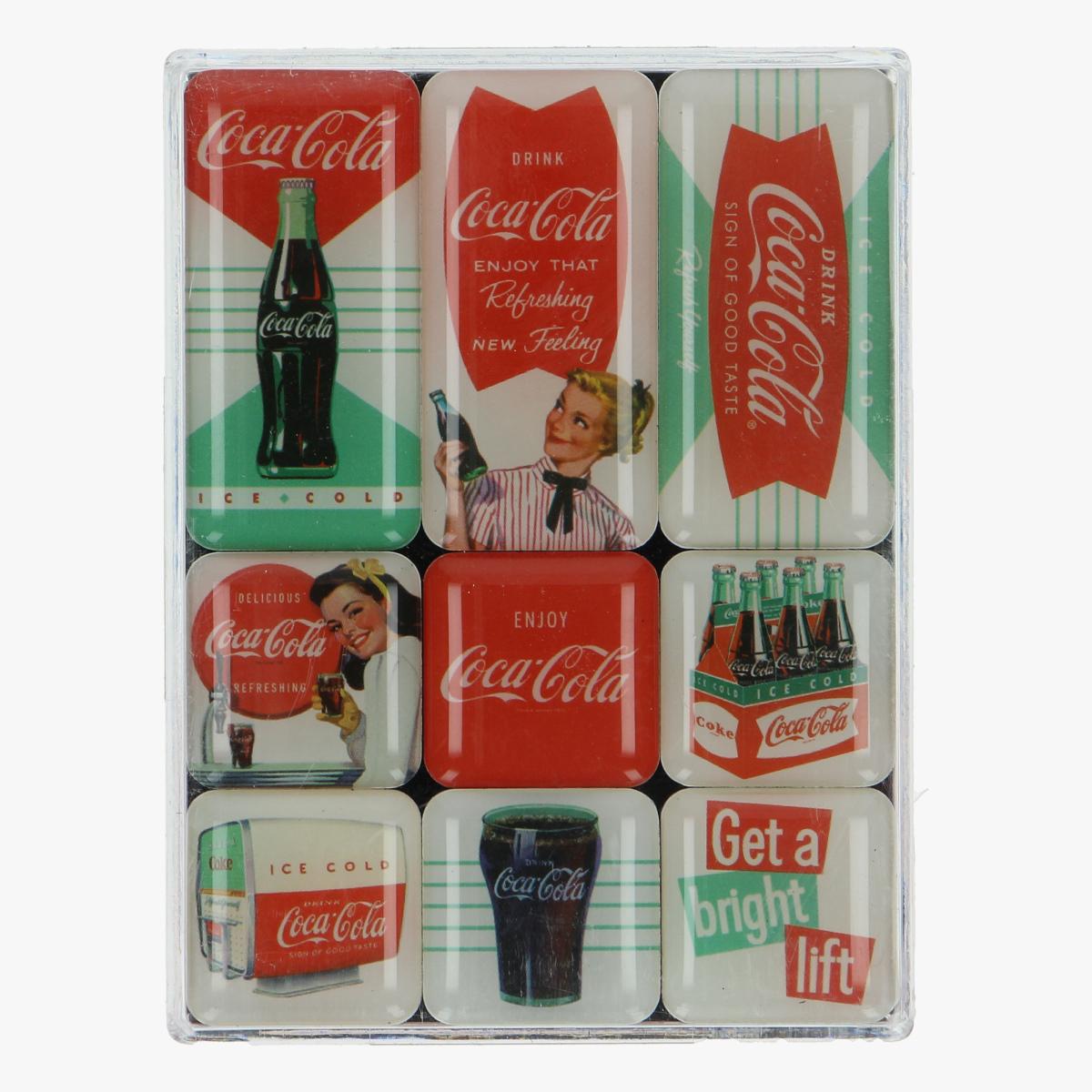 Afbeeldingen van magneetjes coca cola